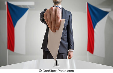 Election or referendum in Czech Republic. Voter holds...