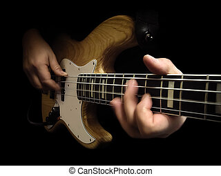 electric bass guitar - bassist playing bass isolated over...