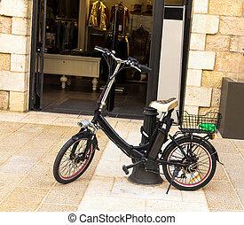 Electric bike near open door of shop