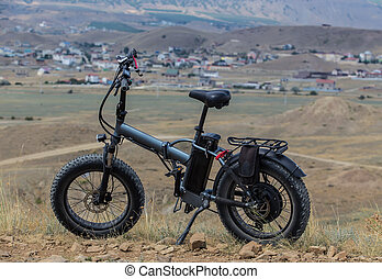 Electric bike on a hill in the mountains