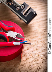 electric cable nippers insulating tape wire strippers on ...