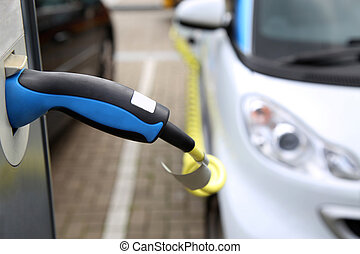 Electric car being charged at the station, close up of the ...