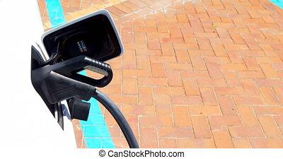 Electric car charging at charging station 4k - Close-up of...