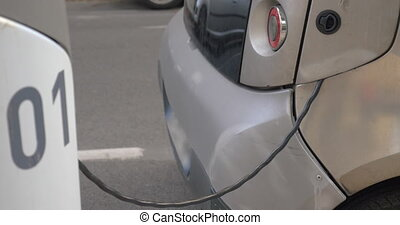 Electric car charging at power supply station - Eco-friendly...