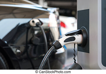 Electric car charging, copy space.