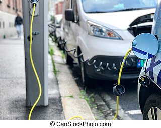 Electric car charging station in Oslo. Eco automobile that...
