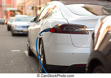 Electric Car in Charging Station. - Power supply for...