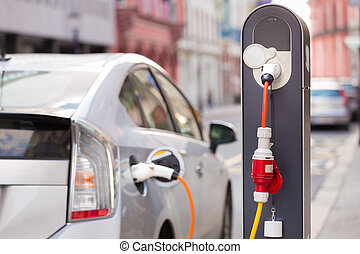 Electric Car in Charging Station. - Power supply for ...