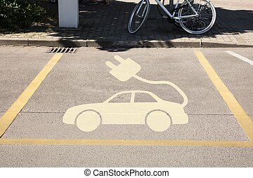 Electric car sign in parking area
