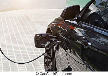 Electric cars are charging electricity to store in car batteries.