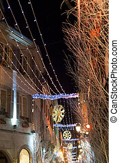 electric christmas garlands in town at night