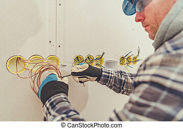 Electric Contractor Straightens Surplus Of Wiring During Installation.
