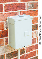 Electric control box on red brick wall