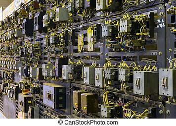 Electric service panel with many switches, automatons and breakers. Benchboard