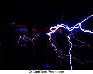 Electric discharge of lightning with the outlines of electric coils in the dark.