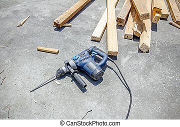 Electric drill, power tool on concrete texture