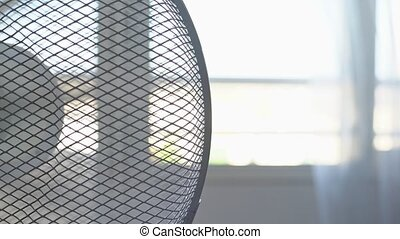 Electric fan for cooling the room in the summer, the heat. Blurred background. High quality 4k footage