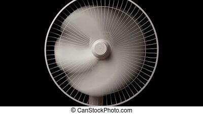 Electric fan on black background. High quality 4k footage