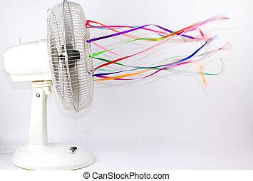 Electric Fan - An electric fan blowing colorful silk ribbons
