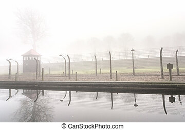 Electric fence in former Nazi camp - Electric fence in...