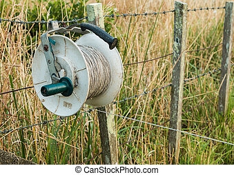 Electric Fence Reel - One used electric fence reel hooked on...