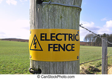 Electric Fence Sign in the Countryside - A sign warning of...