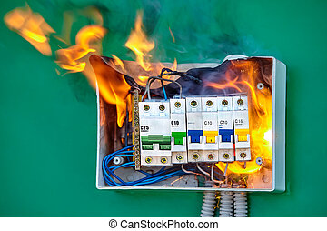 Electric fire as result of an overload in mains. - A short ...