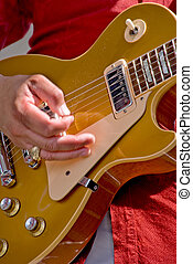 A pop guitarist playing an electric guitar.