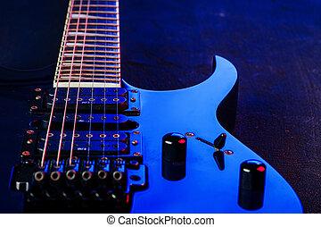 Electric guitar body in the dark close up