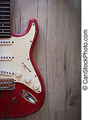 Electric guitar - Red old electric guitar on old wood ...