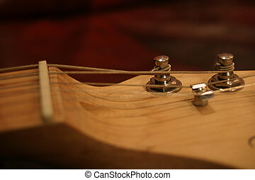 Electric Guitar Tuning Pegs - Closeup view of a set of...