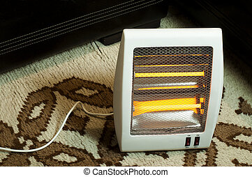 Electric heater with halogen coils. Heater on thick carpet