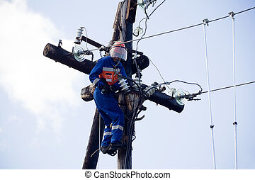 Electric is working on a pole