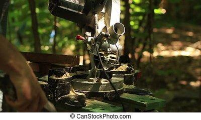 Electric jigsaw cutting a piece of wood