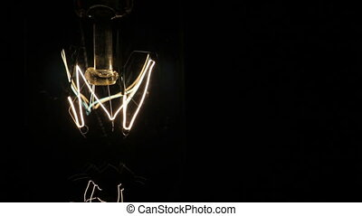 Electric Light a lamp suspended from the ceiling. Black background