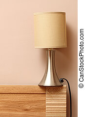 lamp on side wooden bed wall background