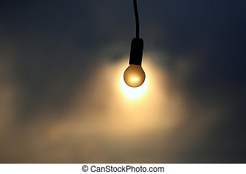 electric lamp on the background of a sunset