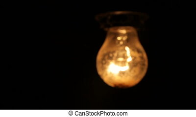 Electric light bulb on a black background