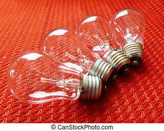 Electric light bulbs on red background