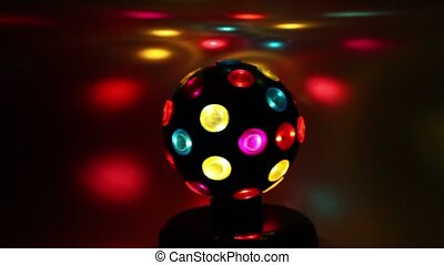 electric light sphere spins and colorful spots move around...
