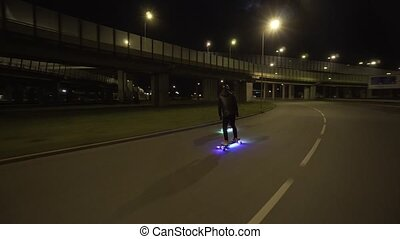 Electric Longboard ride in night city with led and motors