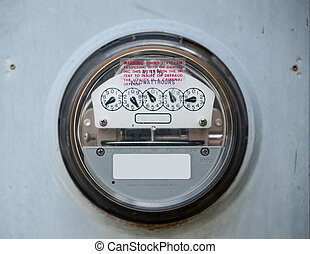 Electric Meter - Closeup of a scratched up electric meter in...