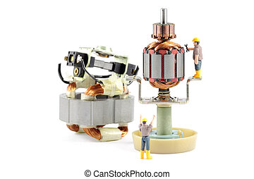Macro photograph of a disassembled electric motor being worked on by two tiny toy engineers, concept.