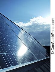 Electric photovoltaic solar panels cells on a home roof