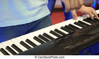 Electric piano, Actor playing on the keyboard synthesizer...