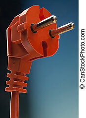 electric plug - orange electric plug with cable on blue...