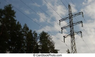 Electric pole in the blue sky. Time lapse