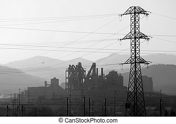 Electric pole towers backlight cloudy sky