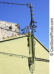 electric pole wire cable detail green house blue sky