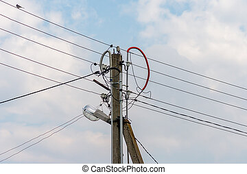 electric pole with wires against blue sky